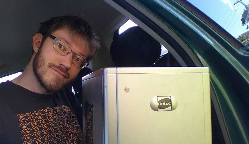 Photo of an Antec Lanboy computer case and Matthew sitting in the back seat of a car
